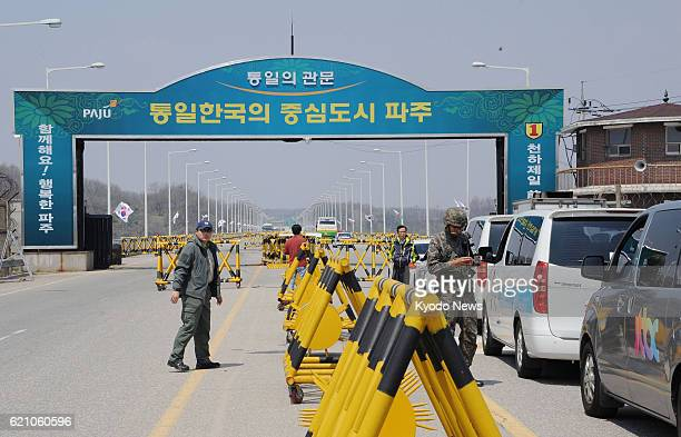 PAJU South Korea Vehicles of South Korean media outlets are on standby in front of a bridge in Paju South Korea on the border with North Korea on...