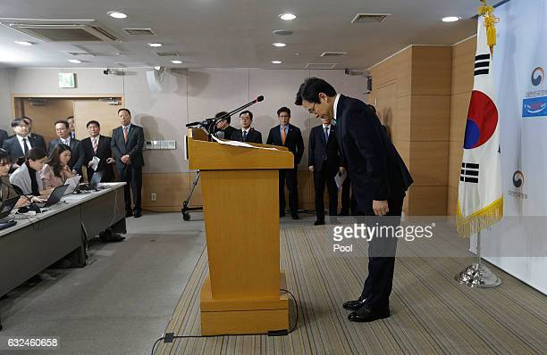 South Korean acting President and Prime Minister Hwang Kyoahn bows to the nation during the New Year's press conference at the government complex on...