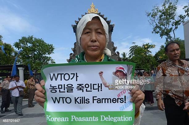 A South Korean activist holds a poster while activists around the world called La Via Campesina Social Movement for an Alternatif Asia hold a peace...