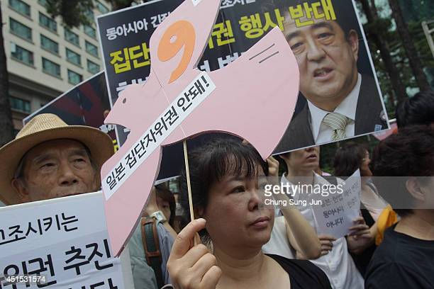 South Korean activists hold a rally at the Japanese Embassy against Japan's collective selfdefense plan on July 1 2014 in Seoul South Korea Japanese...
