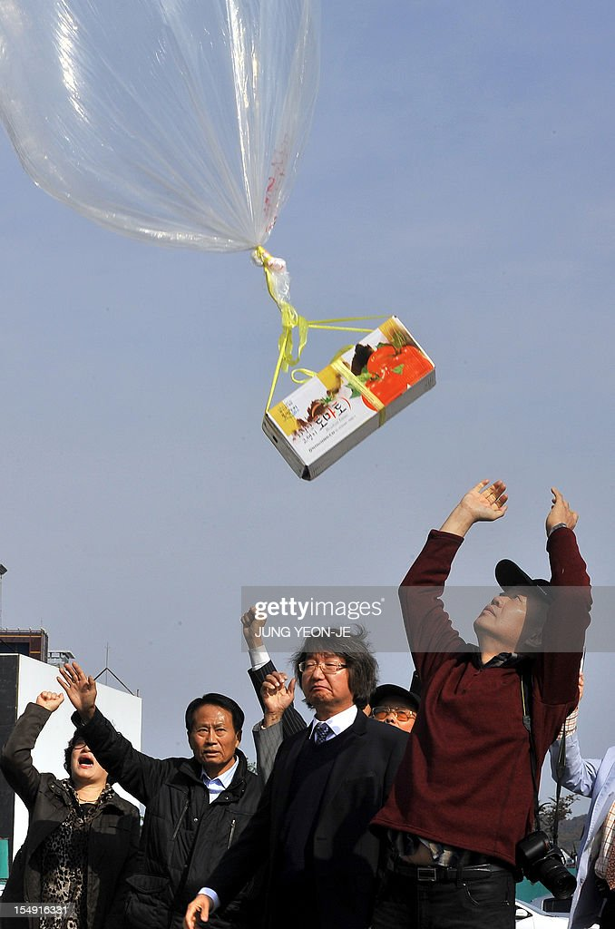 South Korean activists release a balloon carrying anti-North Korea leaflets at a park in the border town of Paju, north of Seoul, on October 29, 2012. South Korean activists floated anti-Pyongyang leaflets across the border with North Korea on October 29 a week after the North threatened military action over a similar propaganda exercise.