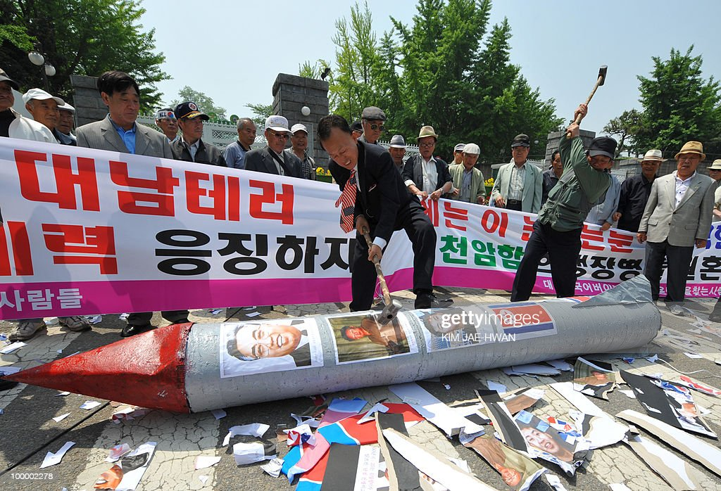 South Korean activists smash a mock North Korean missile with sledge hammers in front of the defence ministry buidling in Seoul on May 20, 2010. A multinational investigation team said a torpedo fired by a North Korean submarine sank a South Korean warship near the disputed maritime border with the loss of 46 lives on March 26.