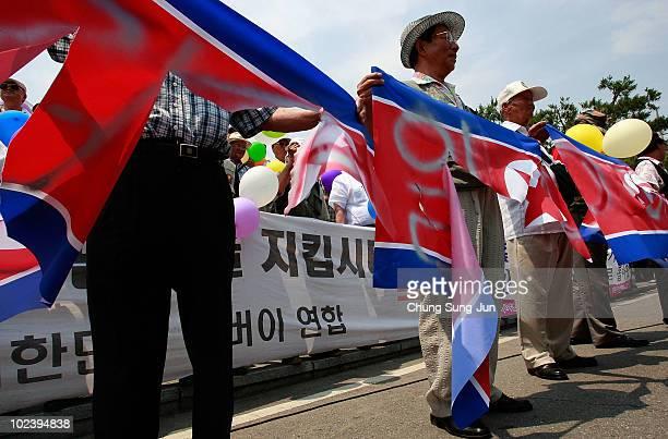 South Korean activists tear North Korean flags before the release of helium balloons carrying 'propaganda' leaflets destined for North Korea to mark...