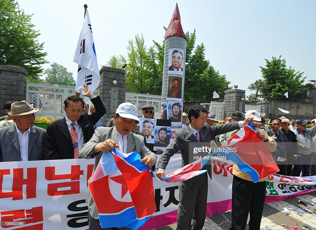 South Korean activists tear up mock North Korean flags in front of the defence ministry buidling in Seoul on May 20, 2010. A multinational investigation team said a torpedo fired by a North Korean submarine sank a South Korean warship near the disputed maritime border with the loss of 46 lives on March 26.