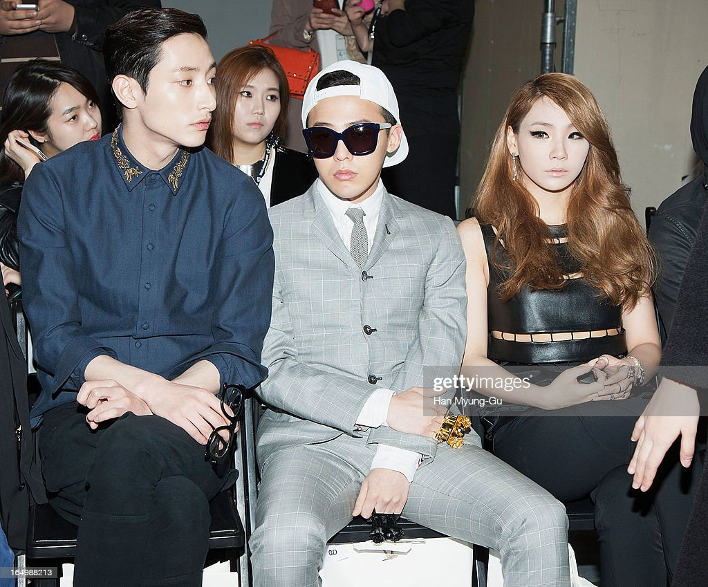 South Korean actor and model Lee Soo-Hyuk, <a gi-track='captionPersonalityLinkClicked' href=/galleries/search?phrase=G-Dragon&family=editorial&specificpeople=7406528 ng-click='$event.stopPropagation()'>G-Dragon</a> of South Korean boy band Bigbang and Lee Chae-Rin (CL) of South Korean girl group 2NE1 attend the 'KYE' show on day four of the Seoul Fashion Week F/W 2013 at IFC Seoul on March 28, 2013 in Seoul, South Korea.