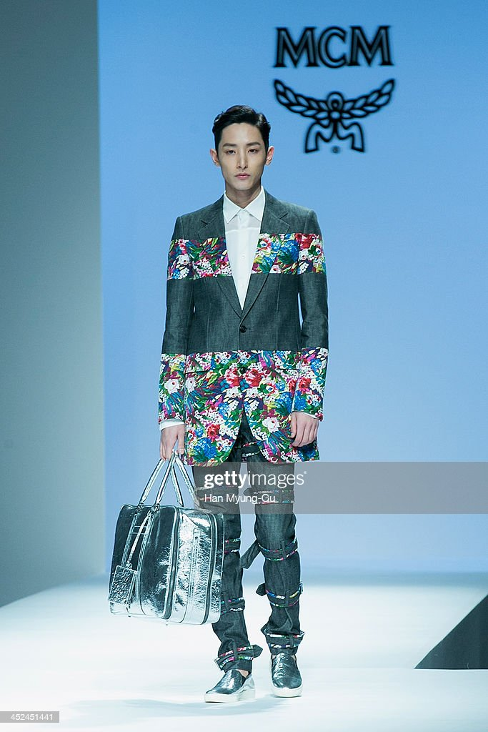 South Korean actor and model Lee Soo-Hyuk walks the runway at the MCM S/S 2014 Seoul Fashion Show at Lotte Hotel on November 26, 2013 in Seoul, South Korea.