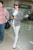 South Korean actor Bae YongJoon is seen upon arrival at Gimpo International Airport on May 25 2013 in Seoul South Korea