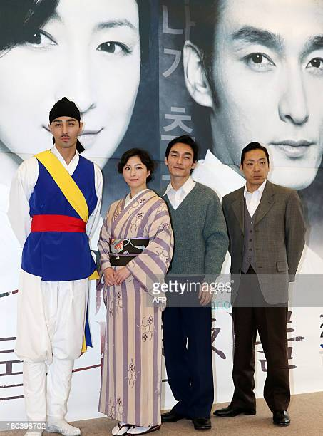 South Korean actor Cha SeungWon Japanese actress Ryoko Hirosue and Japanese actors Tsuyoshi Kusanagi and Teruyuki Kagawa pose together during a press...