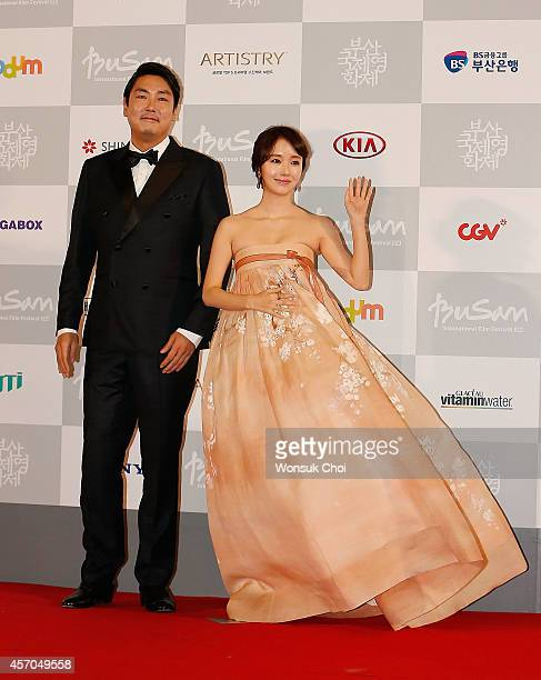 South Korean actor Cho JinWoong and actress Lee JungHyun pose for the photographers during the closing ceremony of the 19th Busan International Film...