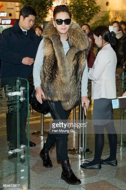 South Korean actor Jang KeunSuk is seen on departure at Gimpo International Airport on December 10 2013 in Seoul South Korea