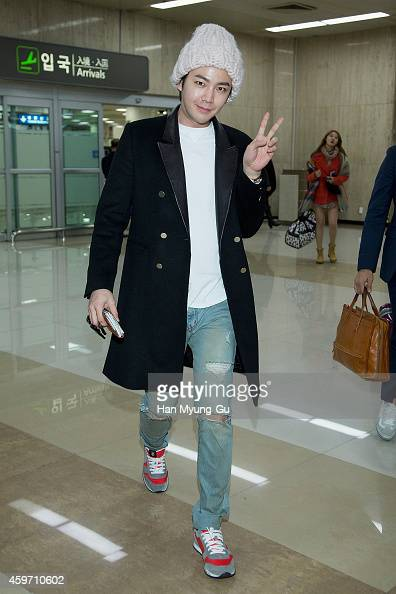 South Korean actor Jang KeunSuk is seen upon arrival at Gimpo International Airport on November 29 2014 in Seoul South Korea