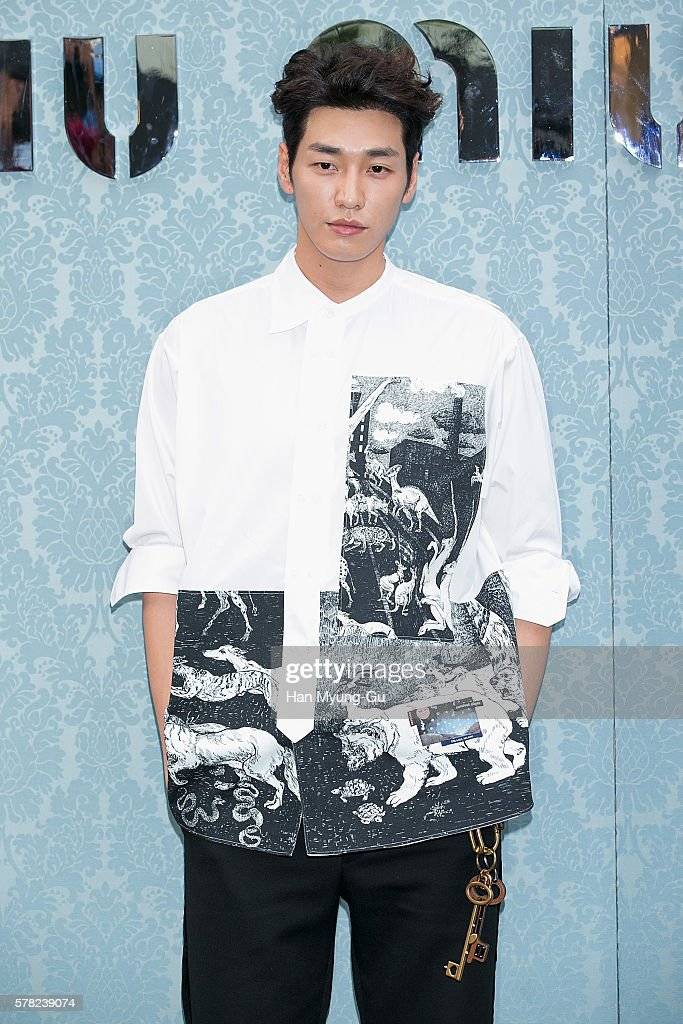 South Korean actor Kim YoungKwang attends the opening event for the Miu Miu Cheongdam Boutique on July 20 2016 in Seoul South Korea