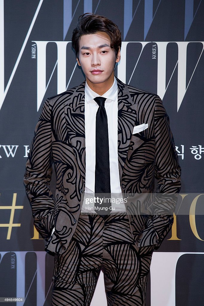 South Korean actor Kim YoungKwang poses for photographs at the W Magazine Korea Breast Cancer Awareness Campaign 'Love Your W' photo call on October...