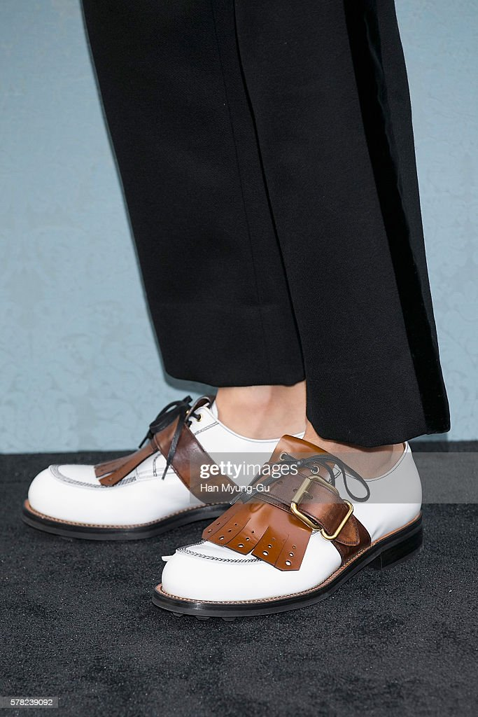 South Korean actor Kim YoungKwang shoe detail attends the opening event for the Miu Miu Cheongdam Boutique on July 20 2016 in Seoul South Korea