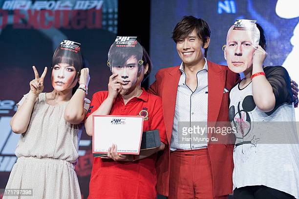 South Korean actor Lee ByungHun poses with fans during the 'RED 2' Showcase at Sheraton Walkerhill on June 28 2013 in Seoul South Korea The film will...