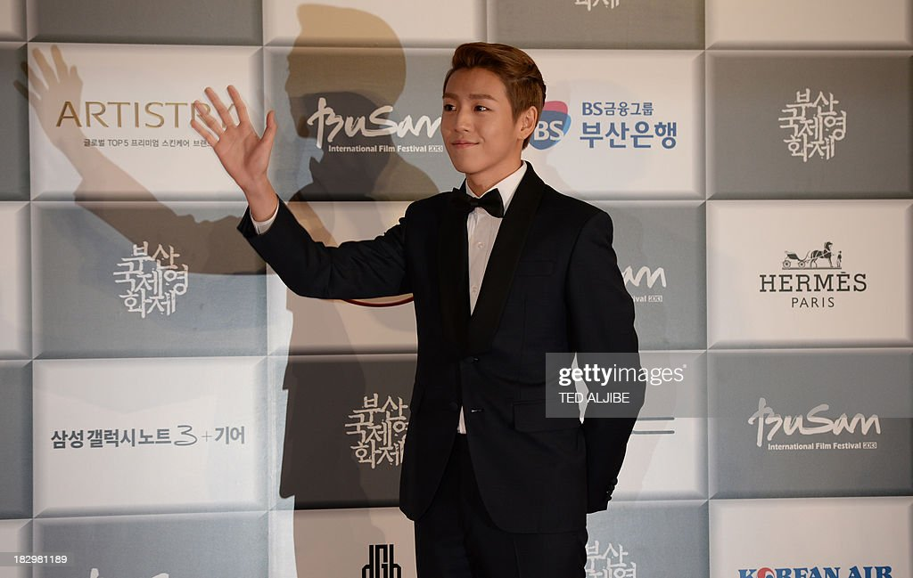 South Korean actor Lee Hyun wu arrives for the opening ceremony of the 18th Busan International Film Festival (BIFF) in Busan on October 3, 2013. Stars of Asian cinema gathered in the South Korean port city of Busan October 3, for the opening of the region's biggest film festival, showcasing new talent in a region where box office takings will soon outstrip North America.