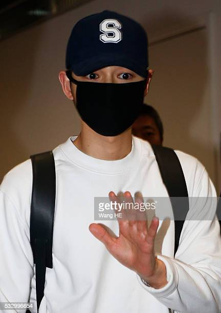 South Korean actor Song Joongki arrives at the airport on May 20 2016 in Wuhan China