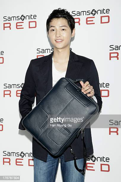 South Korean actor Song JoongKi attends during the 'Samsonite Red' 2013 F/W Collection Presentation at Gallery Yeh on August 8 2013 in Seoul South...