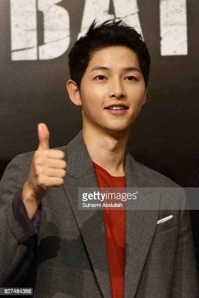 South Korean actor Song Joongki poses for a photo during The Battleship Island Press Conference at Marina Bay Sands Convention Centre on August 8...