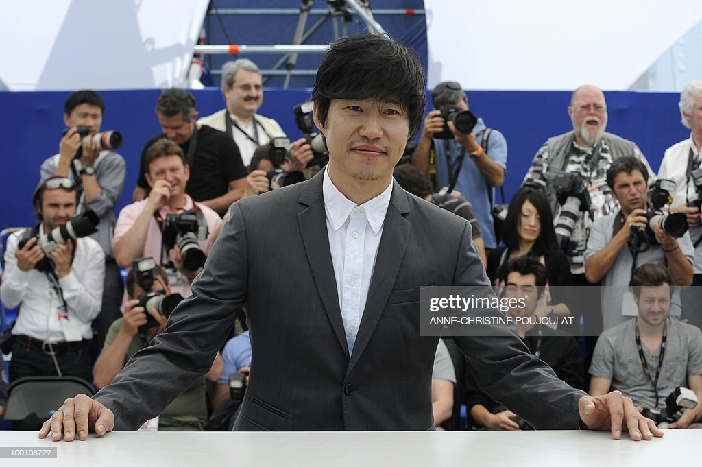 South Korean actor Yu Joonsang pose during the photocall 'Ha Ha Ha' presented in the Un Certain Regard selection at the 63rd Cannes Film Festival on May 21, 2010 in Cannes.