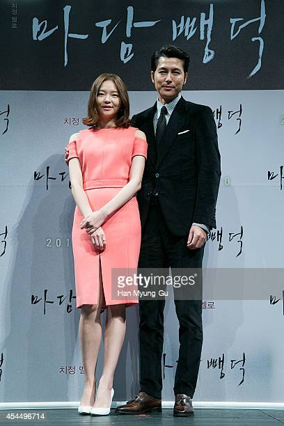 South Korean actors Esom and Jung WooSung attend the press conference for 'Scarlet Innocence' at CGV on September 2 2014 in Seoul South Korea