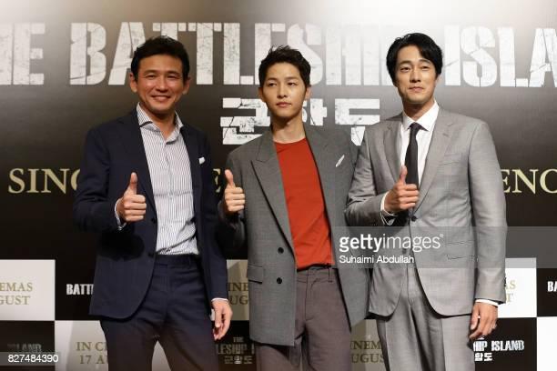 South Korean actors Hwang Jungmin Song Joongki and So Jisub pose for a photo during The Battleship Island Press Conference at Marina Bay Sands...