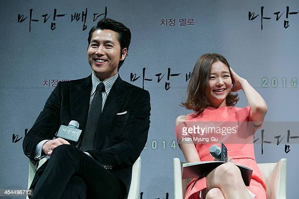 South Korean actors Jung WooSung and Esom attend the press conference for 'Scarlet Innocence' at CGV on September 2 2014 in Seoul South Korea