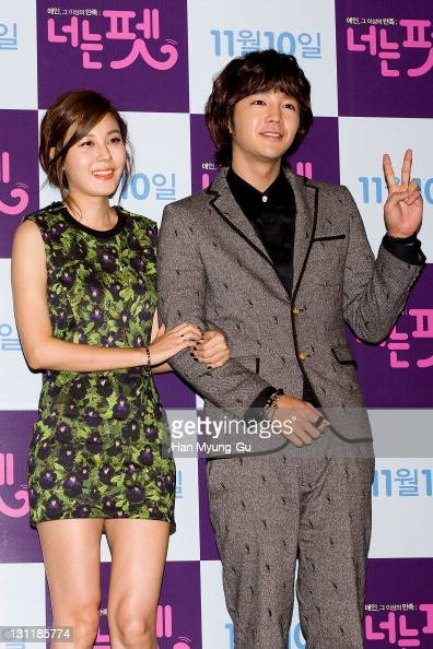 South Korean actors Kim HaNeul and Jang KeunSuk pose for media during a press conference for 'You're My Pet' at Lotte Cinema on November 2 2011 in...