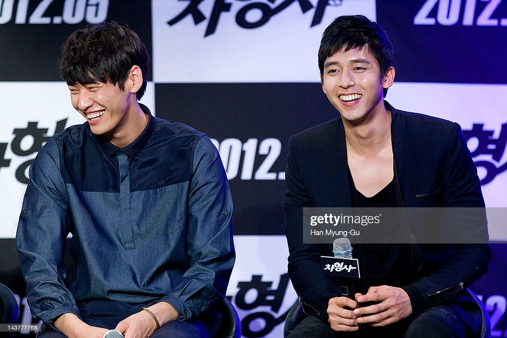 South Korean actors Kim YoungKwang and Shin MinChul attend during at the 'Runway Cop' Korean movie showcase at CGV on May 3 2012 in Seoul South Korea