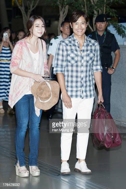 South Korean actors Lee ByungHun and Rhee MinJung are seen on departure at Incheon International Airport on August 12 2013 in Incheon South Korea