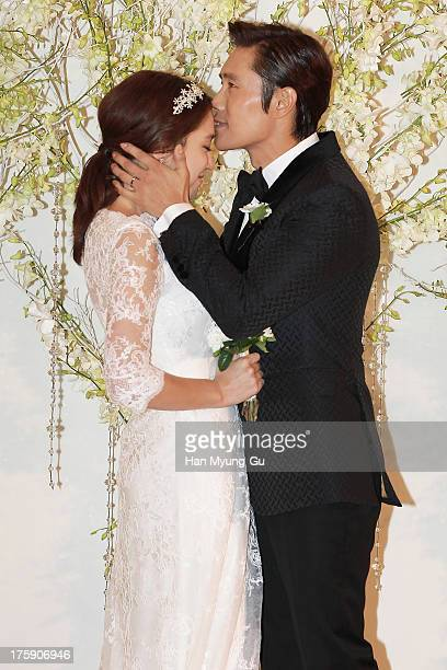 South Korean actors Lee ByungHun and Rhee MinJung pose for photographs before their wedding at the Hyatt Hotel on August 10 2013 in Seoul South Korea