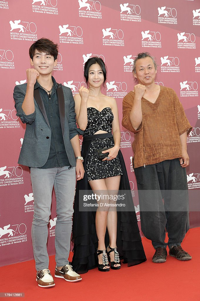 South Korean actors Lee Eun-woo and Seo Young-ju and South Korean director <a gi-track='captionPersonalityLinkClicked' href=/galleries/search?phrase=Kim+Ki-Duk&family=editorial&specificpeople=2212557 ng-click='$event.stopPropagation()'>Kim Ki-Duk</a> attend 'Moebius' Photocall during the 70th Venice International Film Festival at Palazzo del Casino on September 3, 2013 in Venice, Italy.