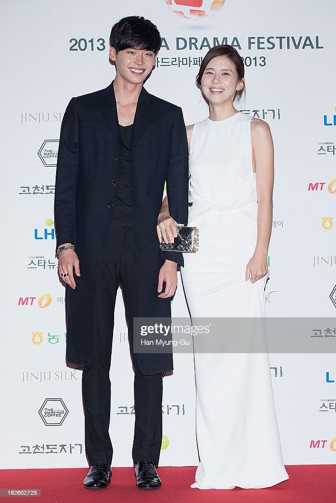 South Korean actors Lee Jong-Suk and <a gi-track='captionPersonalityLinkClicked' href=/galleries/search?phrase=Lee+Bo-Young&family=editorial&specificpeople=4347974 ng-click='$event.stopPropagation()'>Lee Bo-Young</a> arrive for photographs at 2013 Korea Drama Awards at Jinju Arena on October 02, 2013 in Jinju, South Korea.