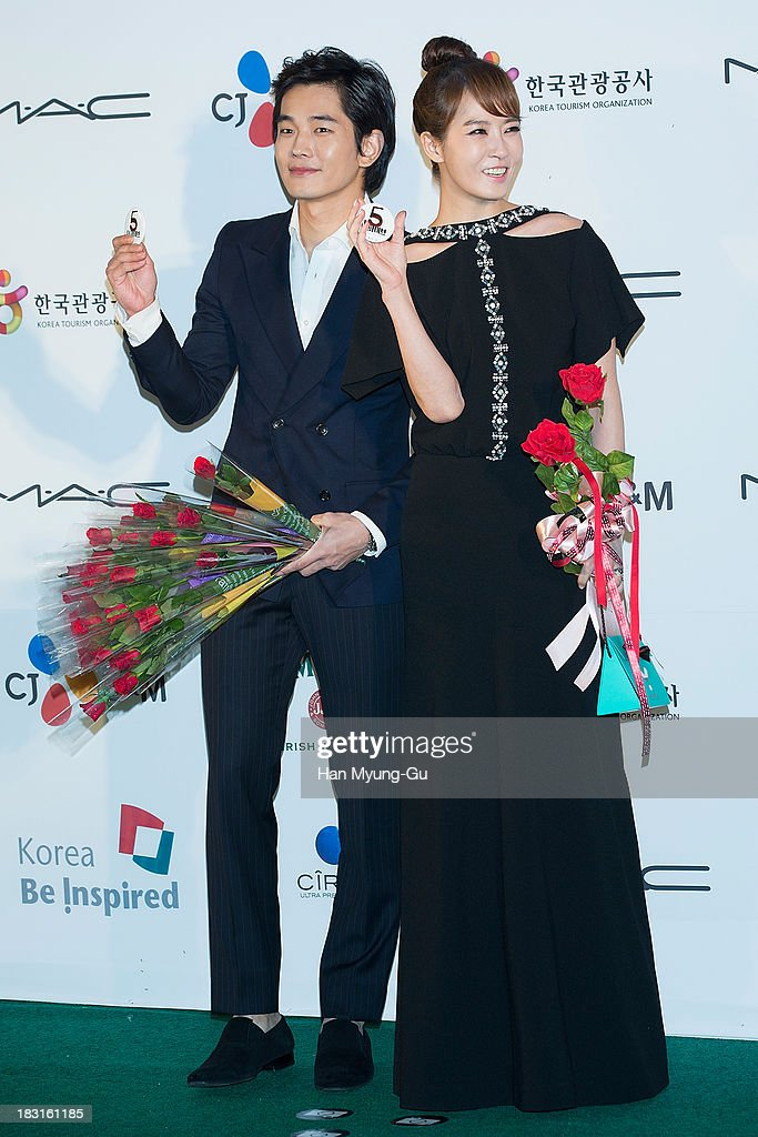 South Korean actors On Ju-Wan and <a gi-track='captionPersonalityLinkClicked' href=/galleries/search?phrase=Kim+Sun-A&family=editorial&specificpeople=4360741 ng-click='$event.stopPropagation()'>Kim Sun-A</a> arrive for APAN Star Road during the 18th Busan International Film Festival (BIFF) at the Haeundae Beach BIFF Village on October 4, 2013 in Busan, South Korea. The biggest film festival in Asia showcases 299 films from 70 countries and runs from October 3-12.