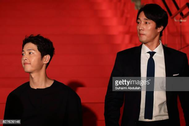 South Korean actors Song Joongki and So Jisub arrive for The Battleship Island red carpet at The MasterCard Theatres at Marina Bay Sands on August 8...