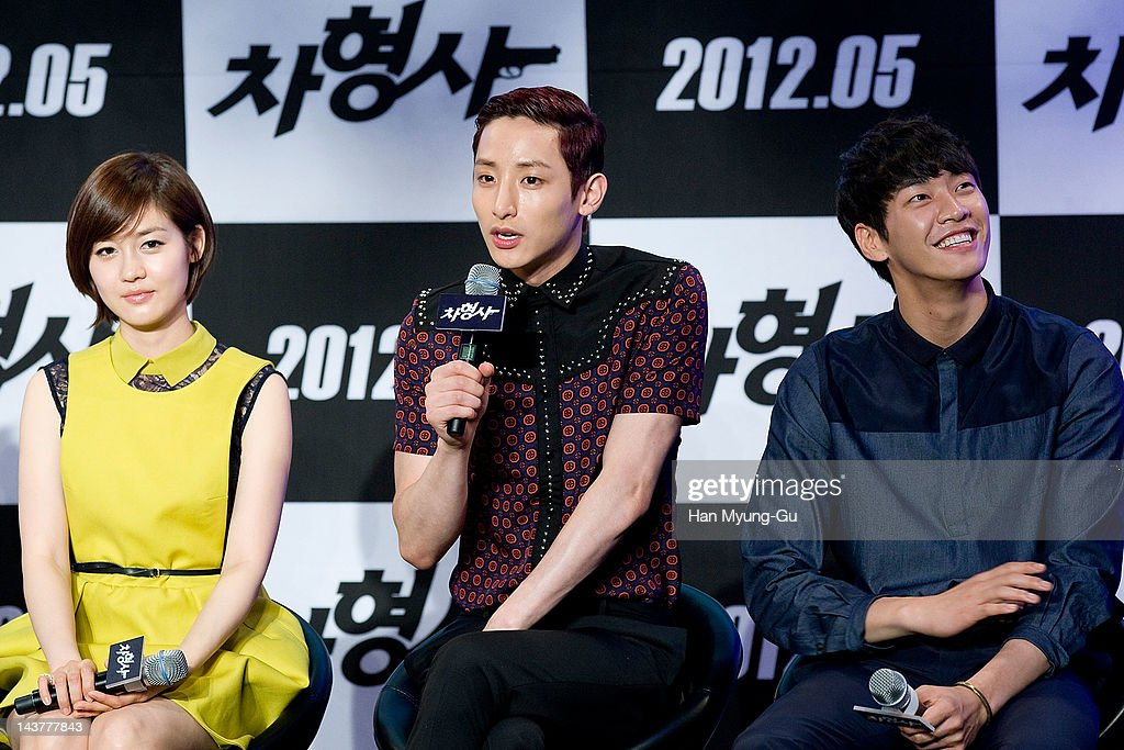 South Korean actors Sung YouRiLee SooHyuk and Kim YoungKwang attend during at the 'Runway Cop' Korean movie showcase at CGV on May 3 2012 in Seoul...