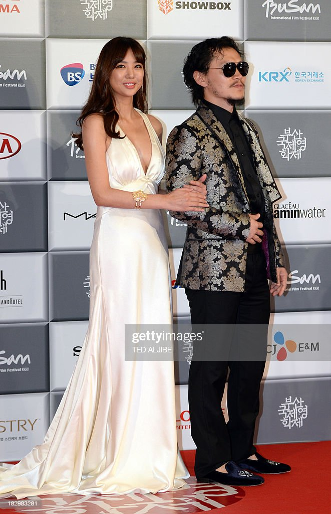 South Korean actors Yang Dong Yeun (R) and Lee Tae Im arrive for the opening ceremony of the 18th Busan International Film Festival (BIFF) in Busan on October 3, 2013. Stars of Asian cinema gathered in the South Korean port city of Busan October 3, for the opening of the region's biggest film festival, showcasing new talent in a region where box office takings will soon outstrip North America.