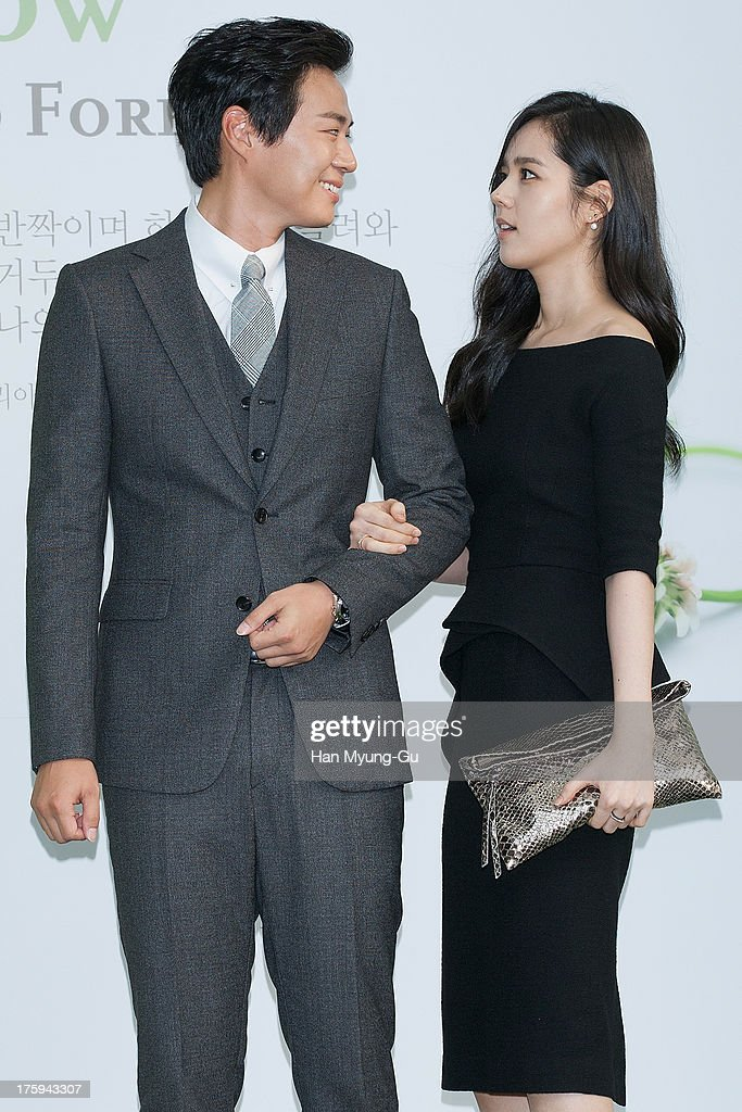 South Korean actors Yeon JungHoon and Han GaIn arrive for wedding ceremony of Lee ByungHun and Rhee MinJung at the Hyatt Hotel on August 10 2013 in...