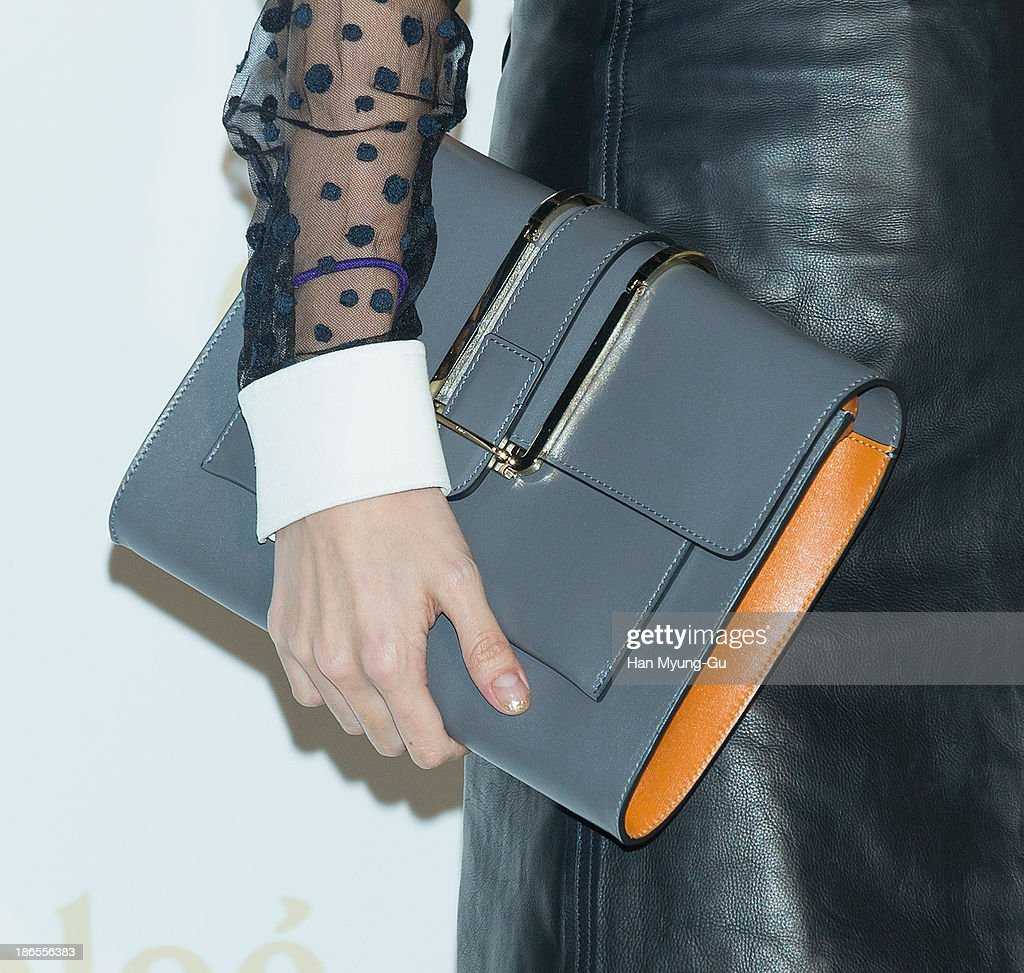 South Korean actress <a gi-track='captionPersonalityLinkClicked' href=/galleries/search?phrase=Han+Chae-Young&family=editorial&specificpeople=829986 ng-click='$event.stopPropagation()'>Han Chae-Young</a> (bag detail) attends the 'Chloe' flagship store grand opening event at Chloe Gangnam Store on November 1, 2013 in Seoul, South Korea.