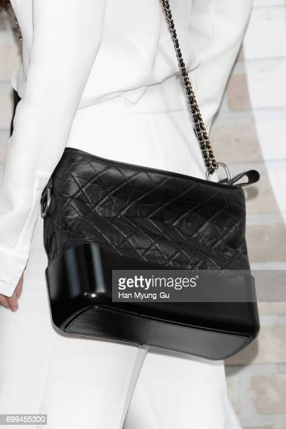 South Korean actress Jung RyeoWon bag detail attends the 'Mademoiselle Prive' exhibition at the DMuseum on June 21 2017 in Seoul South Korea