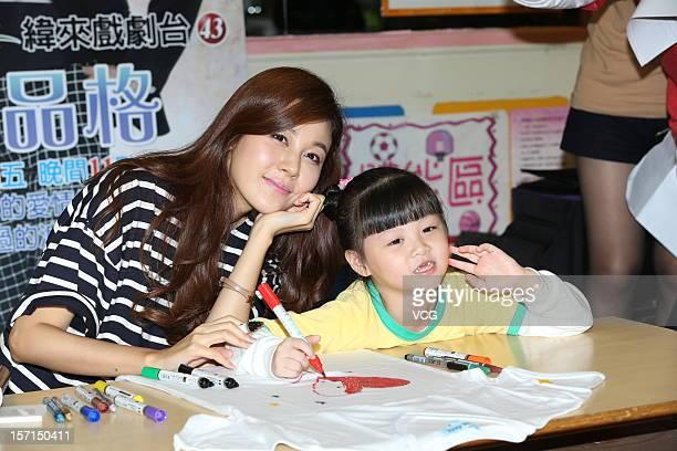 South Korean actress Kim Ha Neul visits a kindergarten on November 28 2012 in Taipei Taiwan