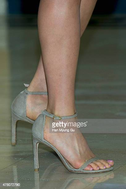 South Korean actress Kim HeeAe shoe detail attends the photocall for 'DELVAUX' popup store at The Galleria Department Store on May 29 2015 in Seoul...