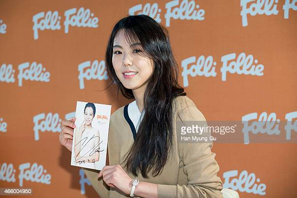 South Korean actress Kim MinHee attends the autograph session for Folli Follie at Lotte Department Store on March 12 2015 in Seoul South Korea