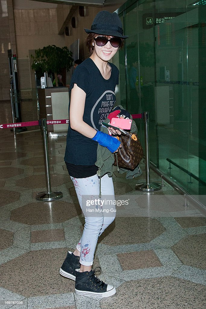 South Korean actress <a gi-track='captionPersonalityLinkClicked' href=/galleries/search?phrase=Kim+Sun-A&family=editorial&specificpeople=4360741 ng-click='$event.stopPropagation()'>Kim Sun-A</a> is seen on departure at Gimpo International Airport on June 1, 2013 in Seoul, South Korea.