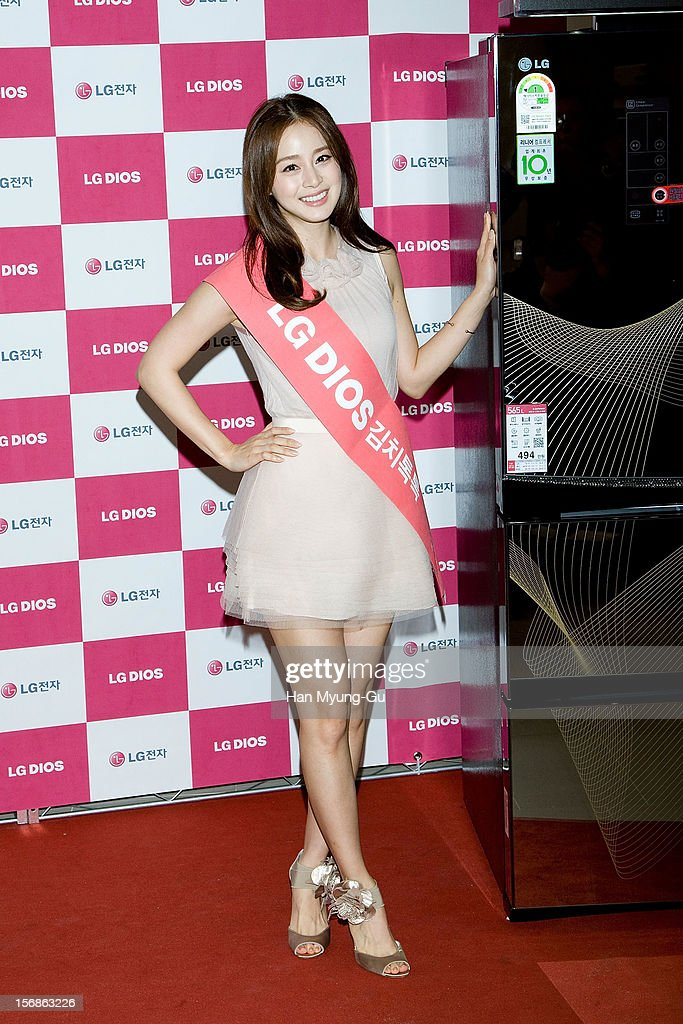 South Korean actress Kim Tae-Hee poses a photography with LG DIOS's Latest Kimchi Refrigerator Machines (K-9100) an autograph session for 'LG Electronics' Bestshop Gangnam Store Opening at LG Bestshop Gangnam Store on November 17, 2012 in Seoul, South Korea.