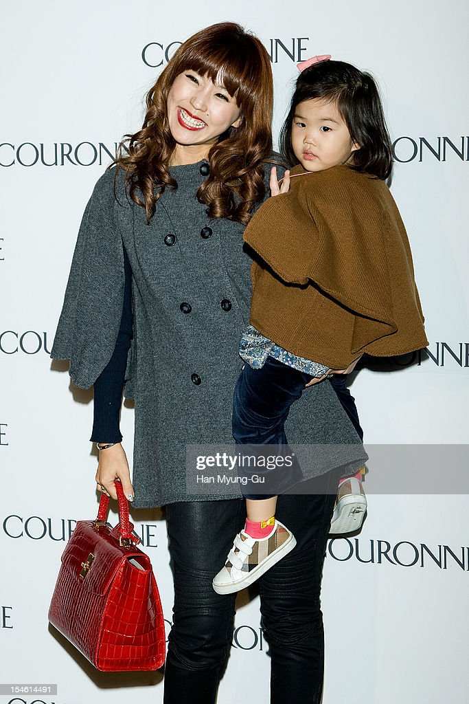 South Korean actress Lee Yoon-Mi (Lee Yun-Mi) and her daughter Joo A-Ra attend during the Promotional event of 'Couronne' Flagship Store Renewal Opening Party at Couronne Gangnam Store on October 23, 2012 in Seoul, South Korea.