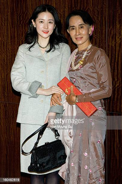 South Korean actress Lee YoungAe and Myanmar's opposition leader Aung San Suu Kyi pose for media after their dinner at the Westin Chosun Hotel on...