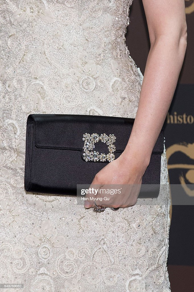 South Korean actress <a gi-track='captionPersonalityLinkClicked' href=/galleries/search?phrase=Lee+Young-Ae&family=editorial&specificpeople=687667 ng-click='$event.stopPropagation()'>Lee Young-Ae</a>, bag detail, attends the photocall for the LG Household and Health Care 'The History Of Whoo' Launch Party at Four Seasons Hotel on June 30, 2016 in Seoul, South Korea.