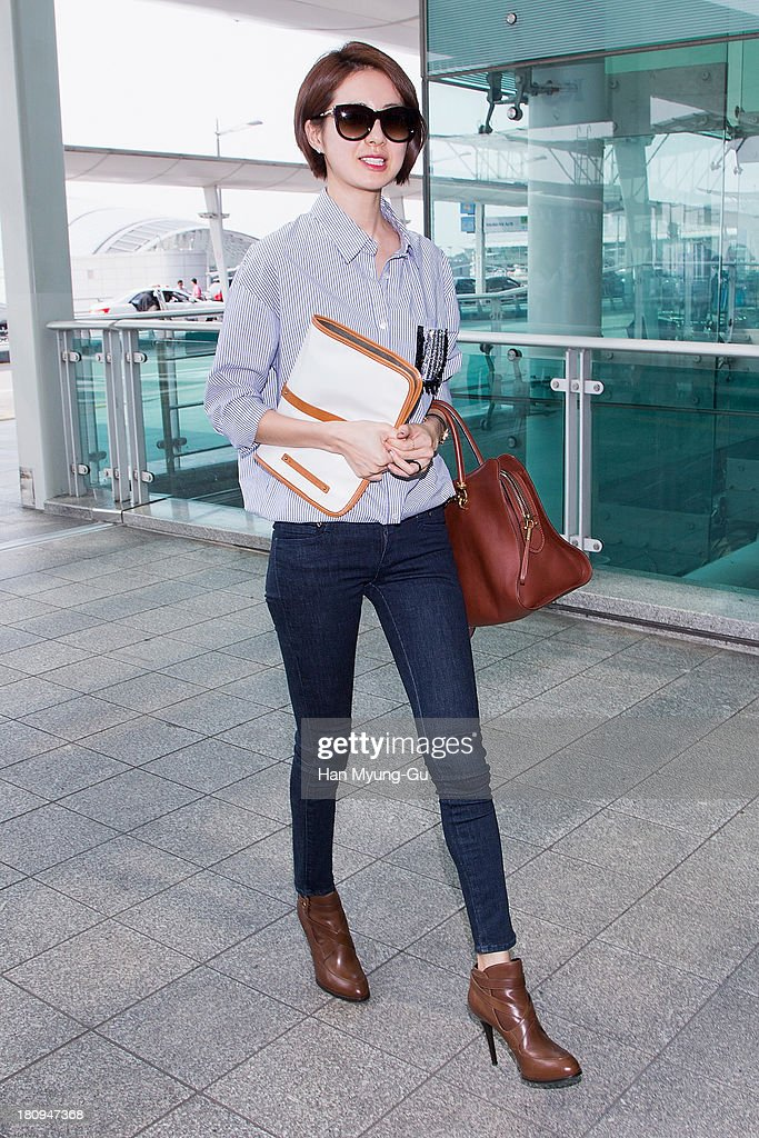 South Korean actress <a gi-track='captionPersonalityLinkClicked' href=/galleries/search?phrase=Lee+Yo-Won&family=editorial&specificpeople=4376729 ng-click='$event.stopPropagation()'>Lee Yo-Won</a> is seen on departure at Incheon International Airport on September 18, 2013 in Incheon, South Korea.