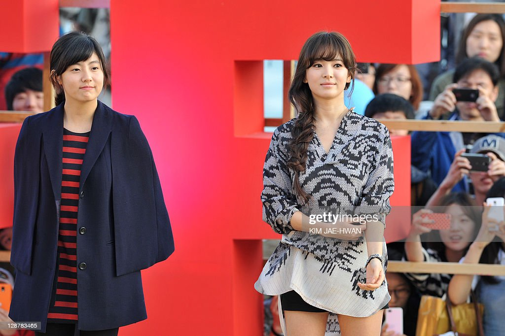South Korean actress Nam Ji-Hyun (L) and actress Song Hye-Kyo (R) attend the greeting event for the film 'A Reason to live' during the Busan International Film Festival (BIFF) on October 8, 2011